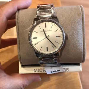 MK woman's Bailey stainless steel watch.